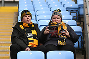 Wasps fans reading todays match programme during the Gallagher Premiership Rugby match between Wasps and Bath Rugby at the Ricoh Arena, Coventry, England on 2 November 2019.