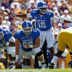 October 1, 2011; Baton Rouge, LA, USA;  Kentucky Wildcats quarterback Morgan Newton (12) against the LSU Tigers during the first quarter at Tiger Stadium.  Mandatory Credit: Derick E. Hingle-US PRESSWIRE / © Derick E. Hingle 2011