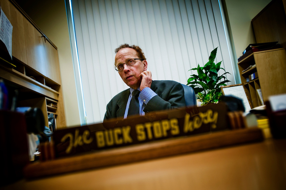 "Warren (outside Detroit) - Mayor James R. Fouts at his desk where he keeps President Truman's famous quote ""The buck stops here""...Photographer: Chris Maluszynski /MOMENT"