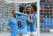 Goal - Riyad Mahrez (26) of Manchester City celebrates scoring a goal to give a 0-4 lead to the away team during the Premier League match between Cardiff City and Manchester City at the Cardiff City Stadium, Cardiff, Wales on 22 September 2018.