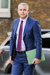 © Licensed to London News Pictures. 16/10/2019. London, UK. Brexit Secretary STEPHEN BARCLAY arrives in Downing Street to attend the weekly cabinet meeting. This week's cabinet meeting was postponed by one day on Tuesday 15 October amid a final push for a Brexit agreement that can be sealed in time for the European Council summit in Brussels on Thursday and Friday. Photo credit: Dinendra Haria/LNP