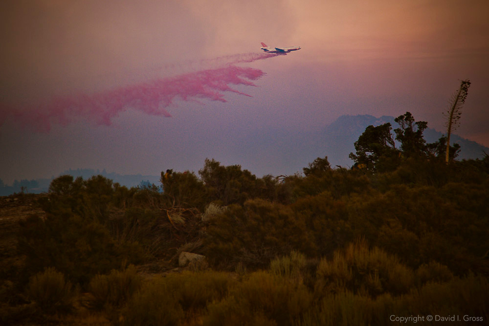 A McDonnell Douglas DC-10 drops a load of retardant on the Station Fire near Los Angeles. The airtanker can carry 12,000 gallons of water or retardant, costs $41,000 per day, looks great on TV, and is best suited for flat terrain, not the steep, hilly canyons of the Station Fire.