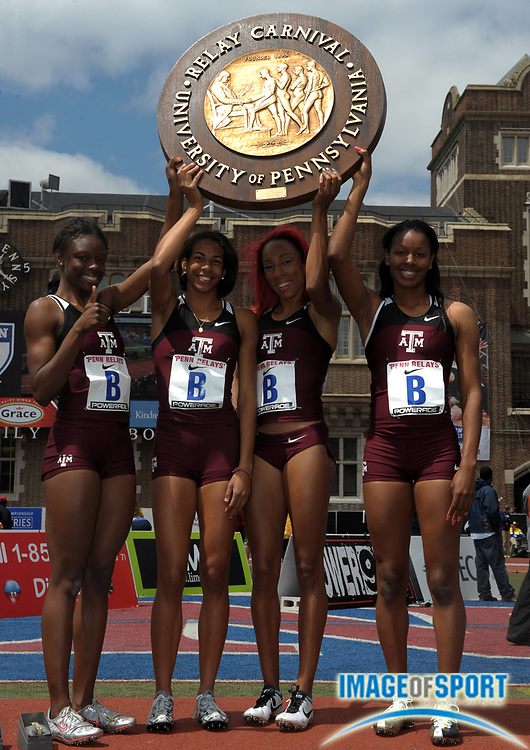 Apr 27, 2012; Philadelphia, PA, USA; Members of the Texas A&M womens 4 x 100m relay pose with the pinwheel after winning the Championship of America race in 43.87 in the 118th Penn Relays at Franklin Field. From left: LaKeidra Stewart and Olivia Ekpone and Dominque Duncan and Ashley Collier.