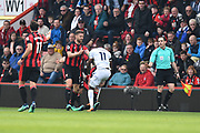 Wilfried Zaha (11) of Crystal Palace tangles with Lewis Cook (16) of AFC Bournemouth and Simon Francis (2) of AFC Bournemouth comes to pull them apart during the Premier League match between Bournemouth and Crystal Palace at the Vitality Stadium, Bournemouth, England on 7 April 2018. Picture by Graham Hunt.