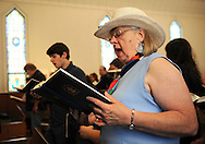 13 MAY 2012 -- FESTUS, Mo. -- Ruth Wisdom (right) joins other worshiper in song during the final church service at the First Presbyterian Church in Festus Sunday, May 13, 2012. The congregation is merging with nearby Grace Presbyterian Church in neighboring Crystal City. Photo © copyright 2012 Sid Hastings.