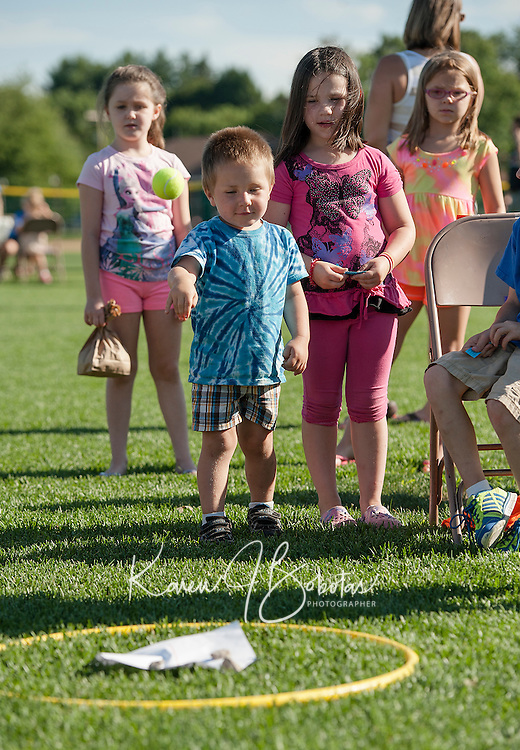John Hoyt takes a throw for the ball toss during the Peanut Festival with Opechee Day Camp Thursday evening.  (Karen Bobotas/for the Laconia Daily Sun)