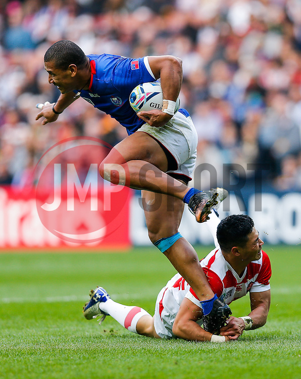 Samoa Outside Centre Paul Perez is tackled by Japan Winger Akihito Yamada - Mandatory byline: Rogan Thomson/JMP - 07966 386802 - 03/10/2015 - RUGBY UNION - Stadium:mk - Milton Keynes, England - Samoa v Japan - Rugby World Cup 2015 Pool B.