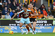 Burnley striker Andre Gray and Wolverhampton Wanderers midfielder Kevin McDonald tussle during the Sky Bet Championship match between Wolverhampton Wanderers and Burnley at Molineux, Wolverhampton, England on 7 November 2015. Photo by Alan Franklin.