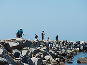 People Fishing Off The Jetty In Dana Point Harbor
