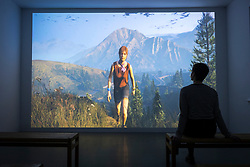 © Licensed to London News Pictures. 05/01/2018. Wakefield UK. Kerry Chase watches the a new episode of Larry Achiampong & David Blandy's FF Gaiden series which uses the virtual landscape of Grand Theft Auto V & shares the story of Alison Catherall, a local resident who has championed social justice at grass roots level. The peice is part of the new Revolt & Revolutions exhibition that is opening at Yorkshire Sculpture Park, drawn from the arts council collection, it gives an insight into counterculture & anti-establishment movements, and shows the work of artists who seek to make a difference- helping to suggest ways that we might contribute to change on an individual, community & global level. Photo credit: Andrew McCaren/LNP