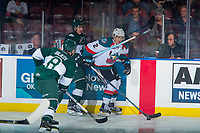 KELOWNA, CANADA - SEPTEMBER 29: James Hilsendager #2 of the Kelowna Rockets is checked at the boards by Patrick Bajkov #8 and Connor Dewar #43 of the Everett Silvertips on September 29, 2017 at Prospera Place in Kelowna, British Columbia, Canada.  (Photo by Marissa Baecker/Shoot the Breeze)  *** Local Caption ***