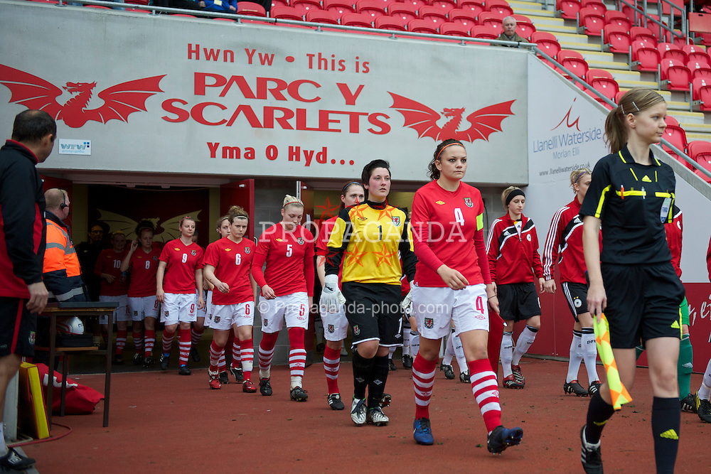 LLANELLI, WALES - Thursday, March 31, 2011: Wales' captain Nia Jones leads her side out to face Germany during the UEFA European Women's Under-19 Championship Second Qualifying Round (Group 3) match at Parc Y Scarlets. goalkeeper Katy Maddock, Lauren Price, Hayley Ladd, Hannah Keryakopolis. (Photo by David Rawcliffe/Propaganda)