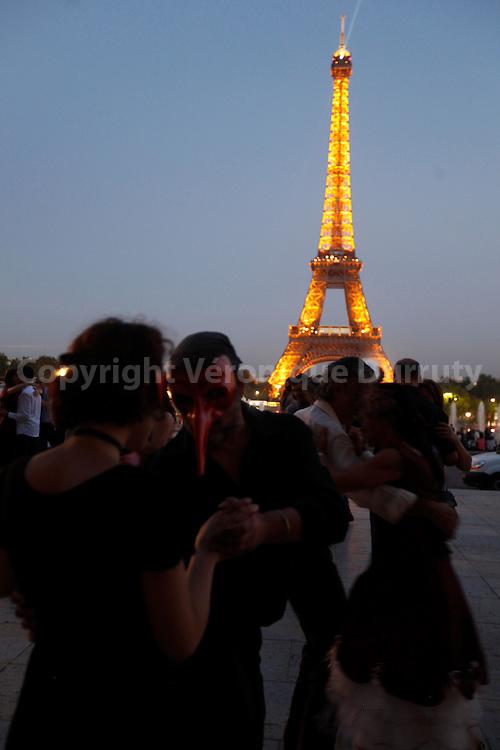 "3Wild"" milonga with masks at the Trocadero, near Eiffel Tower"