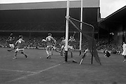 01/09/1968<br /> 09/01/1968<br /> 1 September 1968<br /> All-Ireland Minor Hurling Final: Cork v Wexford at Croke Park, Dublin.<br /> P. Ring scores a goal for the Cork team. Wexford backs, P. O'Brien (4) and A. Kerrigan (5) look on as the ball goes into the net.