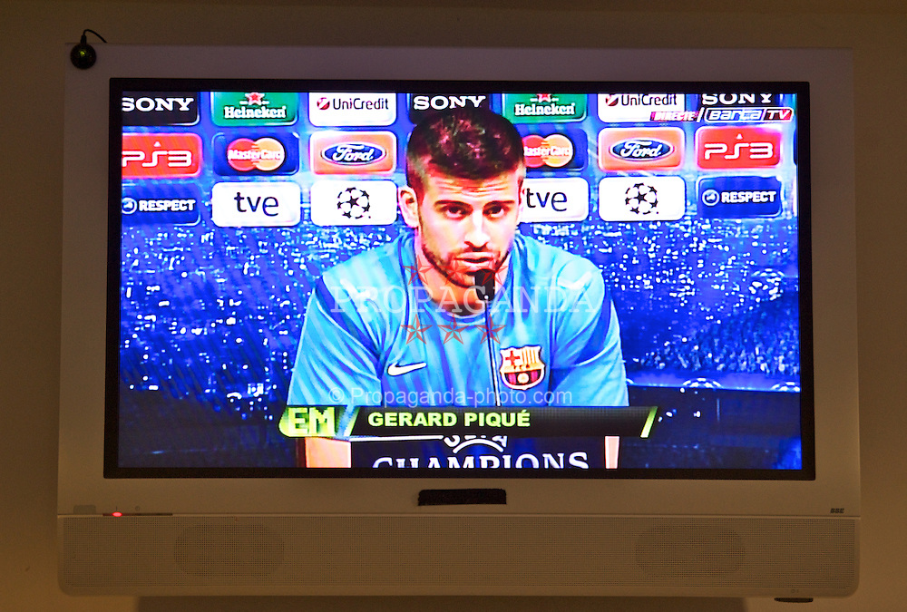 BARCELONA, SPAIN - Monday, April 23, 2012: FC Barcelona's Gerard Pique televised to an annex press room during a press conference at the Camp Nou ahead of the UEFA Champions League Semi-Final 2nd Leg match against Chelsea. (Pic by David Rawcliffe/Propaganda)