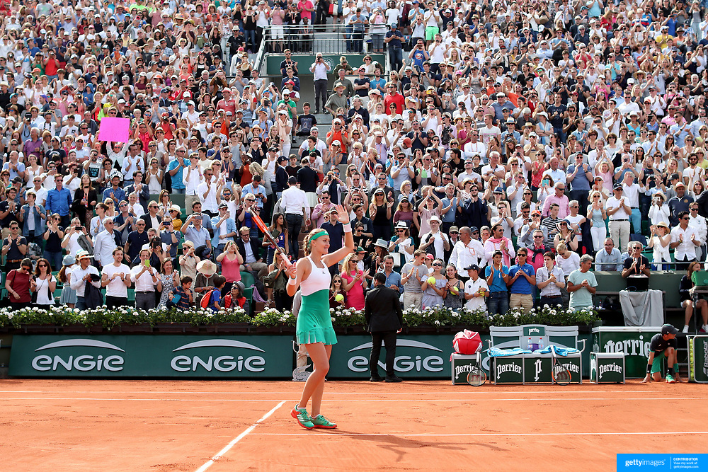 2017 French Open Tennis Tournament - Day Eight.  Kristina Mladenovic of France celebrates her win against Garbine Muguruza of Spain in the Women's Singles round four match in front of a full house on Suzanne-Lenglen Court at the 2017 French Open Tennis Tournament at Roland Garros on June 4th, 2017 in Paris, France.  (Photo by Tim Clayton/Corbis via Getty Images)