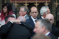 © Licensed to London News Pictures . 20/09/2014 . Manchester , UK . Former head of Rochdale Council Colin Lambert (in glasses). Departures at the funeral of Heywood and Middleton MP Jim Dobbin at Salford Cathedral today (Saturday 20th September 2014) . Photo credit : Joel Goodman/LNP