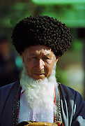 Old man wearing traditional Astrakhan hat in town of Mary in Turkmenistan