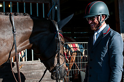 March 22, 2019 - Raeford, North Carolina, US - March 22, 2019 - Raeford, N.C., USA - DOUG PAYNE of the United States and STAR WITNESS relax at their stable before competing in the CCI3-S show jumping division at the sixth annual Cloud 11-Gavilan North LLC Carolina International CCI and Horse Trial, at Carolina Horse Park. The Carolina International CCI and Horse Trial is one of North AmericaÃ•s premier eventing competitions for national and international eventing combinations, hosting International competition at the CCI2*-S through CCI4*-S levels and National levels of Training through Advanced. (Credit Image: © Timothy L. Hale/ZUMA Wire)