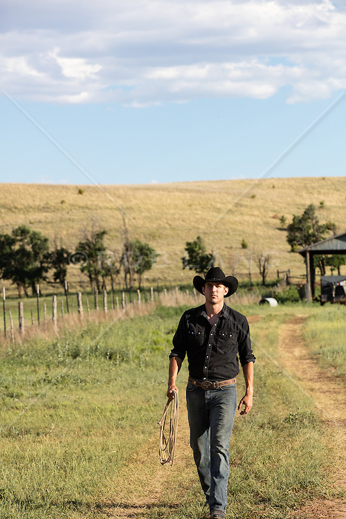 cowboy walking on a ranch in New Mexico