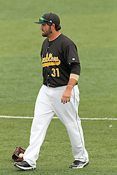 06 July 2013:  Ryan Demmin during a Frontier League Baseball game between the Gateway Grizzlies and the Normal CornBelters at Corn Crib Stadium on the campus of Heartland Community College in Normal Illinois