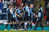 Paris Cowan-Hall of Wycombe Wanderers (2nd left) celebrates scoring the opening goal against Luton Town during the Sky Bet League 2 match at Adams Park, High Wycombe<br /> Picture by David Horn/Focus Images Ltd +44 7545 970036<br /> 26/12/2014