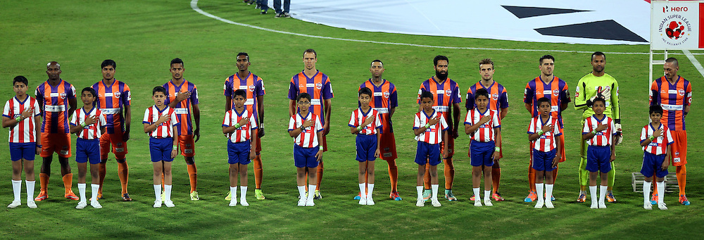 FC Pune City players stand for the national anthem during match 44 of the Hero Indian Super League between FC Pune City and Atletico de Kolkata FC held at the Shree Shiv Chhatrapati Sports Complex Stadium, Pune, India on the 29th November 2014.<br /> <br /> Photo by:  Sandeep Shetty/ ISL/ SPORTZPICS