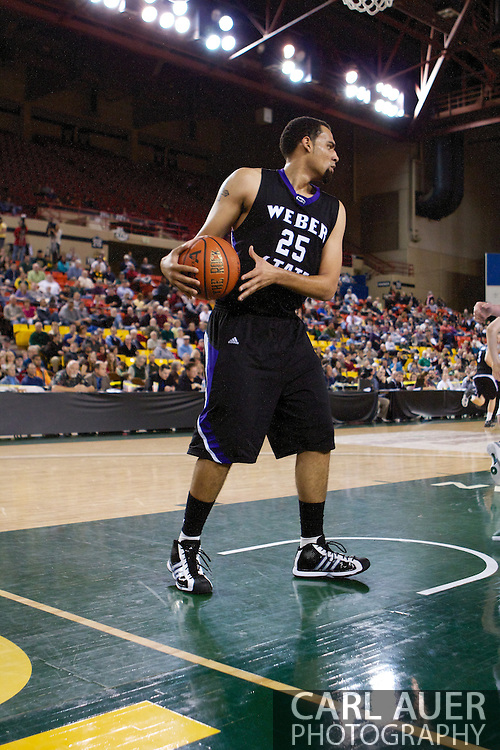 November 25th, 2010:  Anchorage, Alaska - Weber State forward Byron Fulton (25) looks for a pass after grabbing a rebound in the Wildcats 86-54 victory against the University of Alaska-Anchorage Seawolves in their first round game of the Great Alaska Shootout.