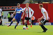 Brentford midfielder Ryan Woods (15)  battling for ball with Ipswich striker Daryl Murphy (9) during the EFL Sky Bet Championship match between Brentford and Ipswich Town at Griffin Park, London, England on 13 August 2016. Photo by Matthew Redman.