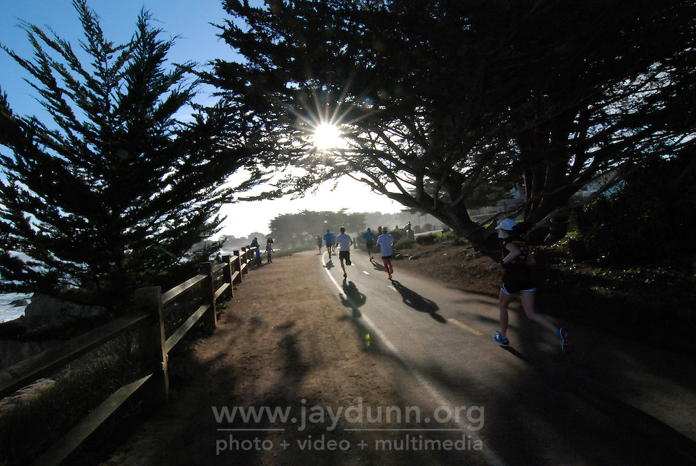 Runners on the way to the finish line at the 13th Big Sur Half Marathon on Sunday along Monterey Bay. In support of their athletes, family and friends line the scenic course, which winds along the coast from El Estero Park in Monterey to Pacific Grove and back, finishing at Customs House Plaza.