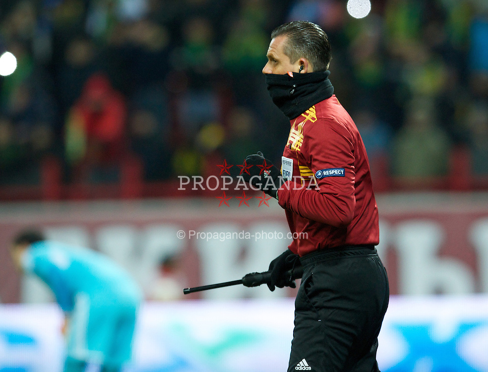 MOSCOW, RUSSIA - Thursday, November 8, 2012: A fourth official wears a snood as FC Anji Makhachkala take on Liverpool during the UEFA Europa League Group A match at the Lokomotiv Stadium. (Pic by David Rawcliffe/Propaganda)