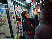 06 JULY 2011 - BANGKOK, THAILAND: An Arab woman in front of a 7-11 in the Soi Arab neighborhood of Bangkok. Soi Arab is an alleyway in Bangkok. What started as an alley has now grown into a neighborhood that encompasses several blocks of restaurants, hotels and money exchanges that cater to Middle Eastern visitors to Thailand. The official name of the street is Sukhumvit Soi 3/1, located in North Nana between Sukhumvit Soi 3 and Sukhumvit Soi 5, not far from the Nana Plaza night-life area and the Grace Hotel popular among Arabs.   PHOTO BY JACK KURTZ