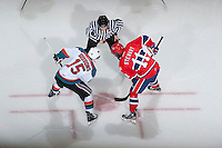 KELOWNA, CANADA - JANUARY 16:  Colton Sissons #15 of the Kelowna Rockets faces off against Liam Stewart #11 of the Spokane Chiefs at the Kelowna Rockets on January 16, 2013 at Prospera Place in Kelowna, British Columbia, Canada (Photo by Marissa Baecker/Shoot the Breeze) *** Local Caption ***