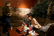 "Ashleigh Buch, center, and friend Rachel Hammes, right, attend ""Manipura"" an intersectional feminist bookclub on Sunday, February 26, 2017 at Sozo Coffeehouse in Omaha."