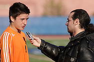 Middletown, New York  - A reporter, at right, interviews a Hicksville High School players after the New York State Class AA  boys' soccer championship game on Nov. 20, 2011.