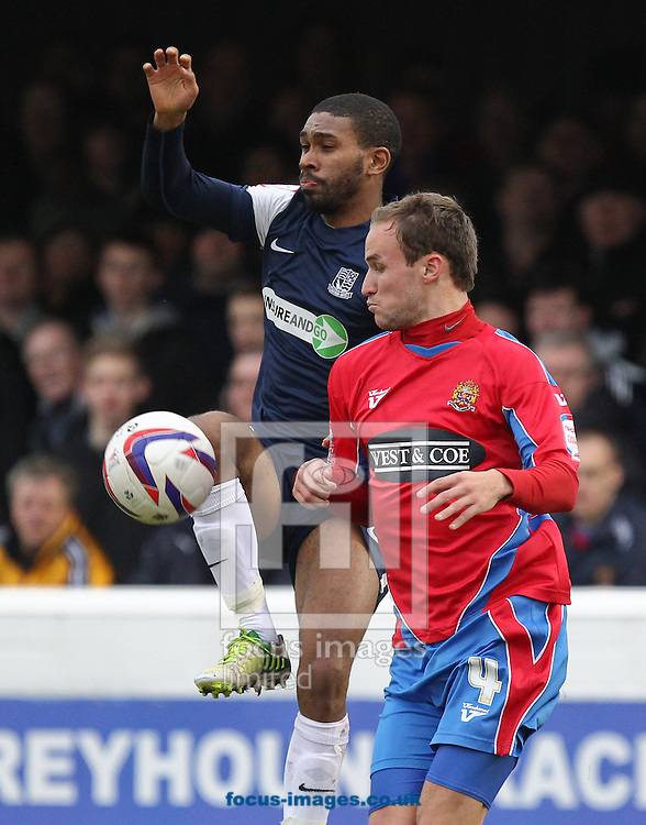 Picture by John  Rainford/Focus Images Ltd +44 7506 538356.26/12/2012.Scott Doe of Dagenham and Redbridge and Gavin Tomlin of Southend United during the npower League 2 match at the London Borough of Barking and Dagenham Stadium, London.