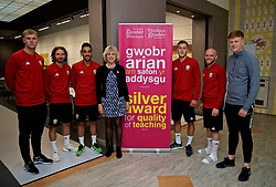 WREXHAM, WALES - Wednesday, June 5, 2019: Glyndwr University Vice-Chancellor Dr Maria Hinfelaar (C) with Wales' Joe Allen, Neil Taylor, Will Vaulks and Jonathan Williams with students at Glyndwr University ahead of the UEFA Euro 2020 Qualifying Group E match between Croatia and Wales. (Pic by David Rawcliffe/Propaganda)