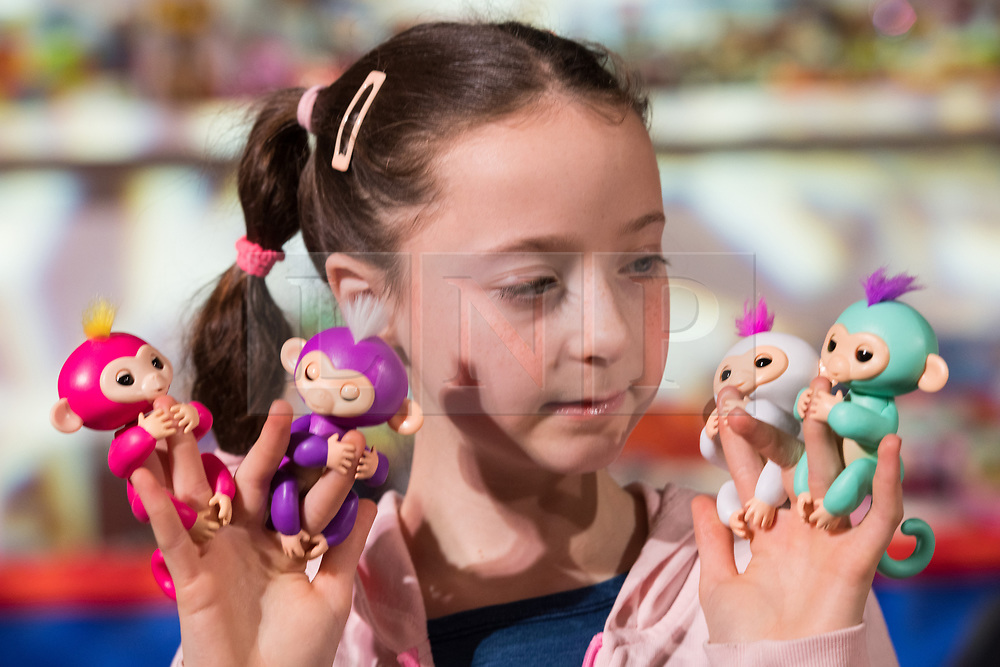 © Licensed to London News Pictures. 08/11/2017. London, UK. A young girl plays with interactive Fingerlings is part of the Dream Toys top twelve toys for Christmas 2017. Photo credit: Ray Tang/LNP