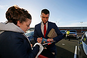 Middlesbrough midfielder Jonathan Howson (16)  signing autographs  during the EFL Sky Bet Championship match between Middlesbrough and Ipswich Town at the Riverside Stadium, Middlesbrough, England on 29 December 2018.