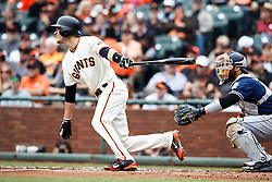 SAN FRANCISCO, CA - MAY 25: Kelby Tomlinson #37 of the San Francisco Giants hits an RBI single against the San Diego Padres during the second inning at AT&T Park on May 25, 2016 in San Francisco, California.  (Photo by Jason O. Watson/Getty Images) *** Local Caption *** Kelby Tomlinson