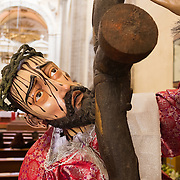 A statue depicting Christ carrying the cross in Iglesia de la Santisima Trinidad in Mexico City, Mexico. Iglesia de la Santisima Trinidad translates as Church of the Holy Trinity.