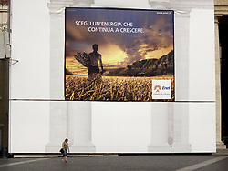 ITALY ROME 2JUL09 - Pedestrians in front of a giant Enel power company poster at St. Peter's Square in Vatican City, Rome.....jre/Photo by Jiri Rezac..© Jiri Rezac 2009