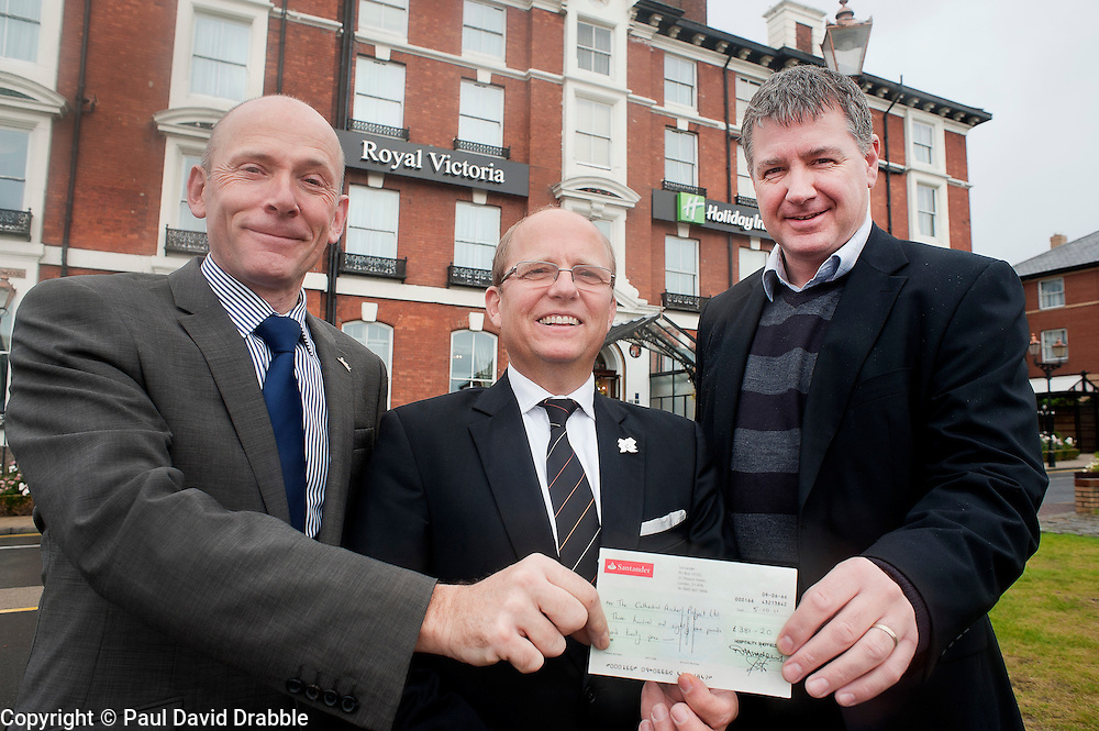 Ian Slater Chairman of Hospitality Sheffield and Hermann Beck Managing Director of Holiday Inn Royal Victoria Hotel hand over a cheque for £381 to Tim Renshaw CEO of the Sheffield Cathedral Archer Project on Tuesday.11th October 2011. Image © Paul David Drabble