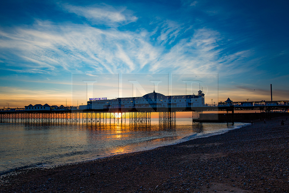 © Licensed to London News Pictures. 30/10/2017. Brighton, UK. A colourful sky behind Brighton Palace pier in Brighton and Hove at sunset. Photo credit: Hugo Michiels/LNP