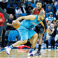 01 November 2015: Atlanta Hawks guard Kent Bazemore (24) defends on Charlotte Hornets forward Nicolas Batum (5) during the Atlanta Hawks 94-92 victory over the Charlotte Hornets, at the Time Warner Cable Arena, in Charlotte, North Carolina, USA.
