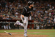 Apr 28, 2017; Phoenix, AZ, USA; Colorado Rockies infielder Trevor Story (27) watches the ball in flight after hitting a solo homer during the third inning against the Arizona Diamondbacks at Chase Field. Mandatory Credit: Jennifer Stewart-USA TODAY Sports