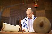 Bayne Albin rehearses his Bar Mitzvah at Temple Beth Abraham in Oakland, California, on April 30, 2014. (Stan Olszewski/SOSKIphoto)