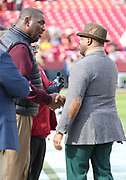 Nov 18, 2018; Landover, MD, USA; Executive Director of the National Football League Players Association (NFLPA), DeMaurice Smith greets former Washington Redskins quarterback Doug Williams at FedEx Field before a game between the Houston Texans and the Redskins. The Texans beat the Redskins 23-21. (Steve Jacobson/Image of Sport)