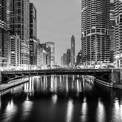 Downtown Chicago River at night black and white photo with State Street Bridge (Bataan-Corregidor Memorial Bridge) and Marina City towers. Photo is ultra high resolution. Copyright ⓒ 2019 Paul Velgos with All Rights Reserved.