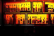 Israel, Eilat Nightlife bottles in a dark bar